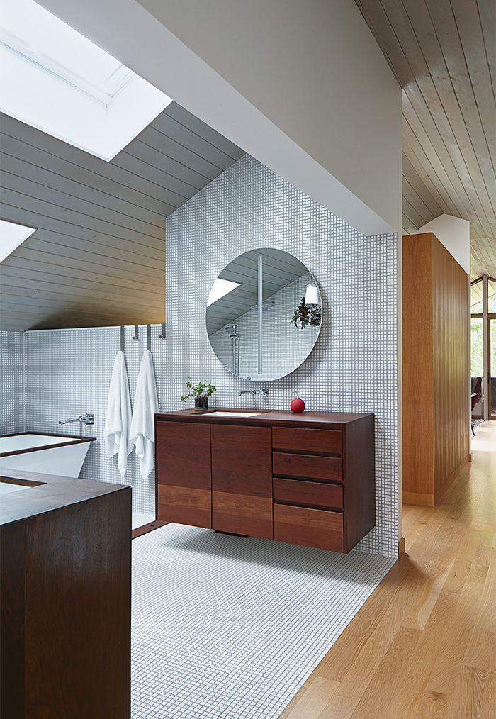 Kansas City master bathroom with walnut vanity and aluminum tub