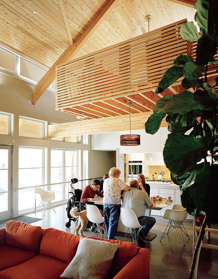 Modern universal design home in Baltimore with cedar beams and concrete floors in the dining area