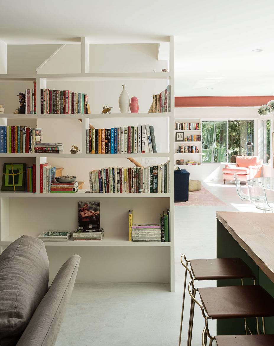 Built-ins filled with books enliven this home's central core.