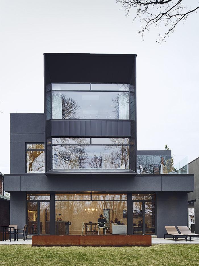 Modern box home clad in Cor-Ten steel