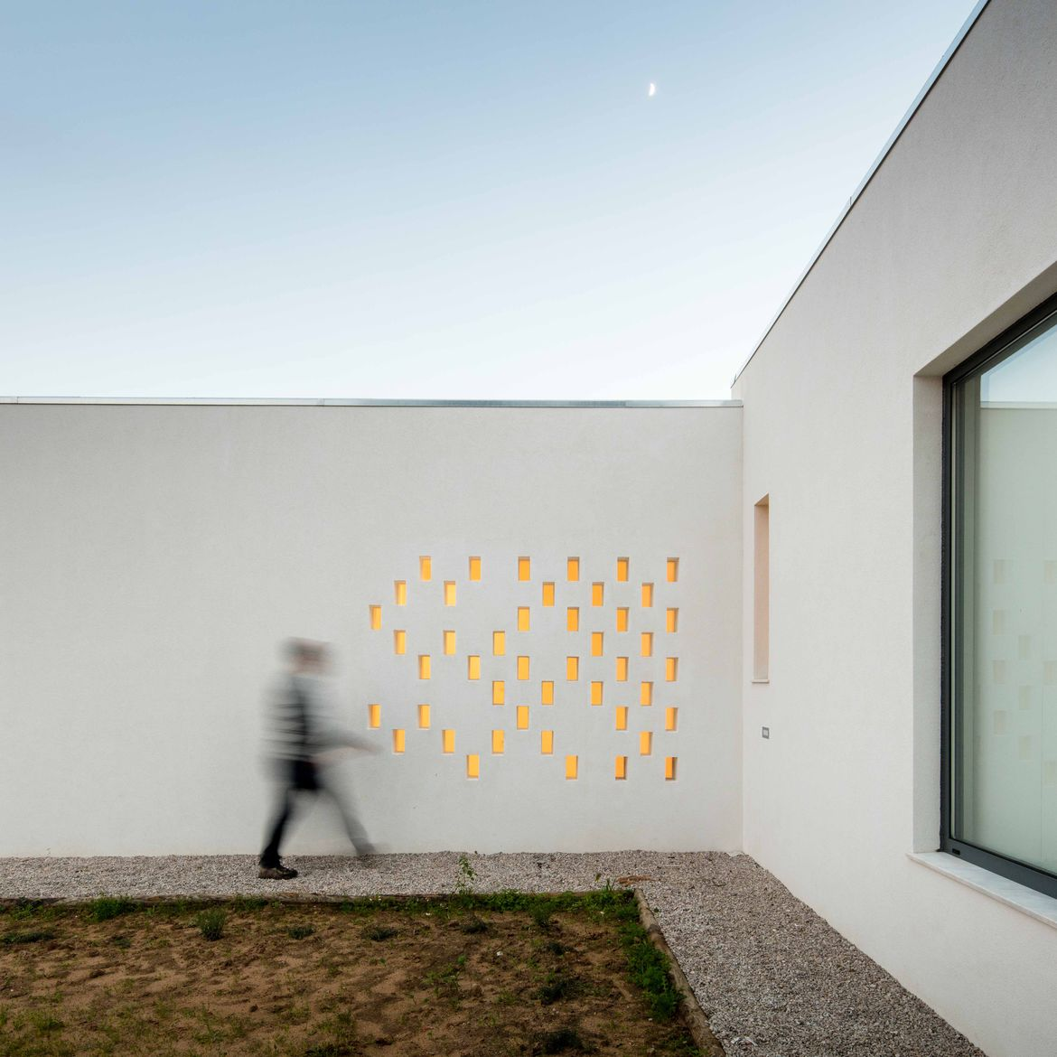 Scattershot openings in a single-story home in Portugal