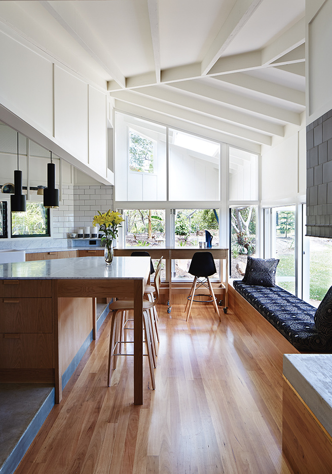 Modern timber house kitchen with blackbutt wood flooring