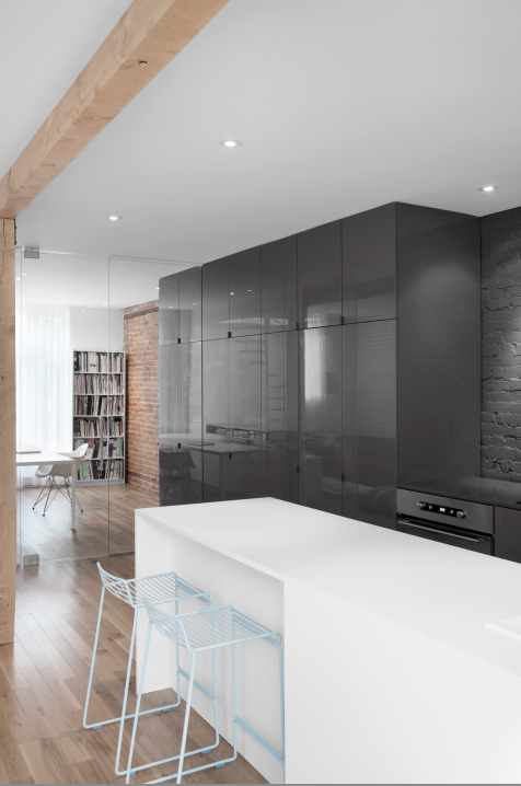 Glossy thermoplastic surfaces in kitchen of Montreal renovation by Anne Sophie Goneau