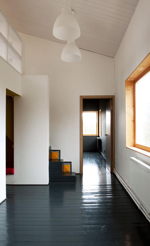 Low Budget House pine flooring and IKEA lighting.
