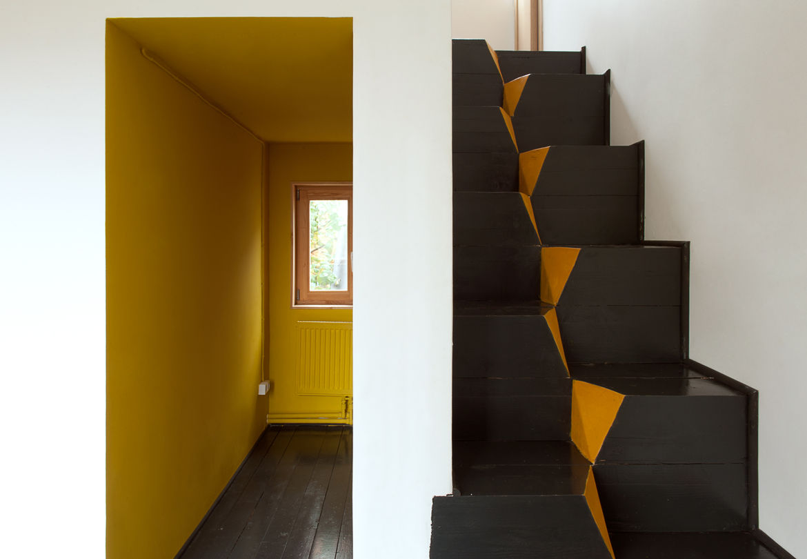 Low Budget House goose-step stairs.