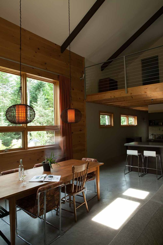 Quebec cabin wood dining room polished concrete floor.