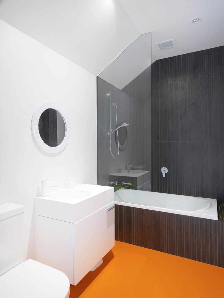 Bathroom in a renovated 1850s prefab cottage in Melbourne