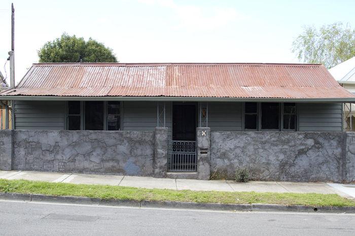 Original front exterior of a 1850s prefab cottage in Melbourne