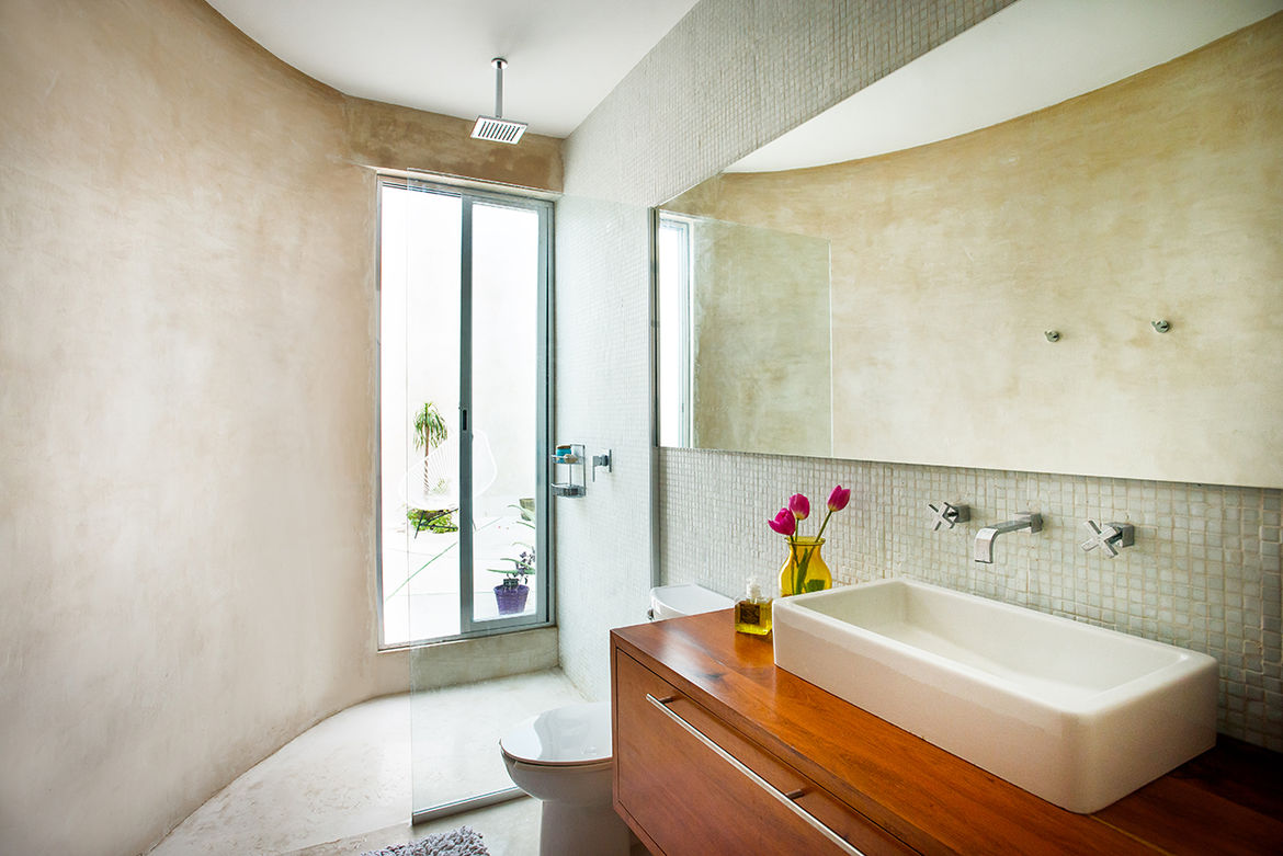 Curved modern bathroom with polished concrete walls