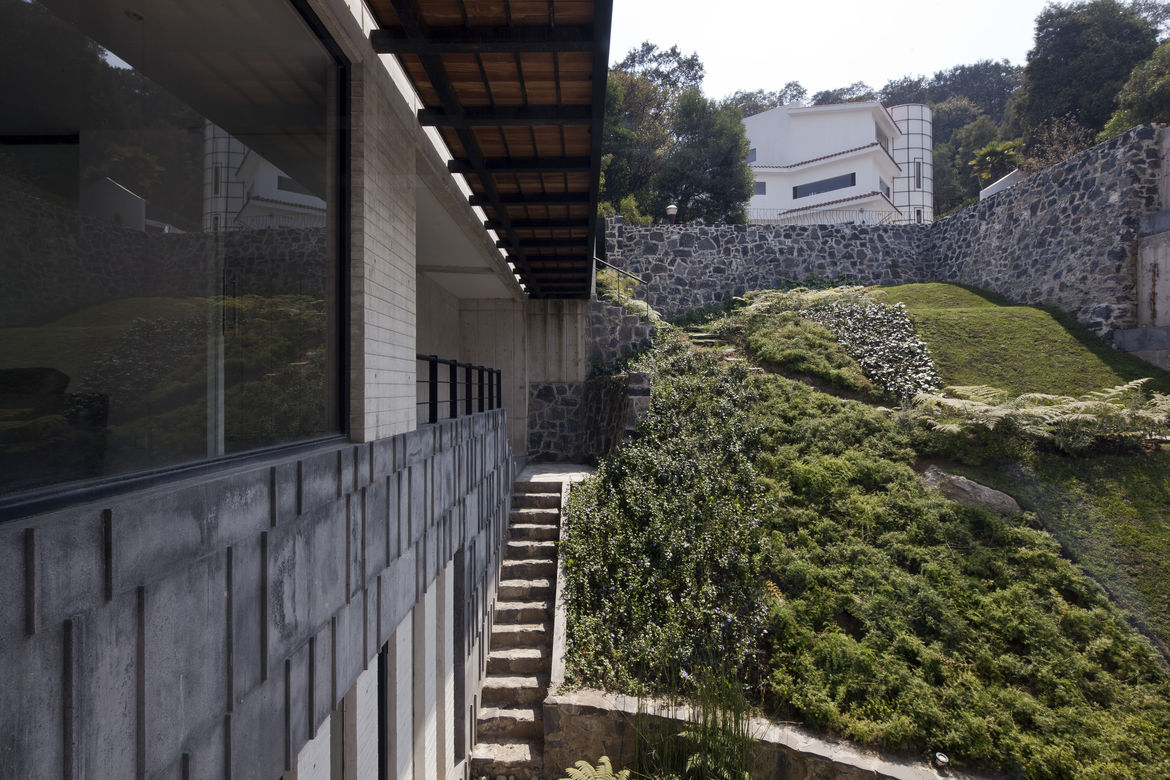 View of the hill and stone wall from Casa U