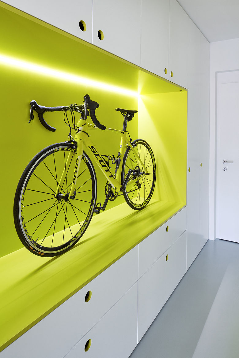 Bike storage and polyurethane floors in hallway of Prague guest apartment by Mjölk and DDAANN.