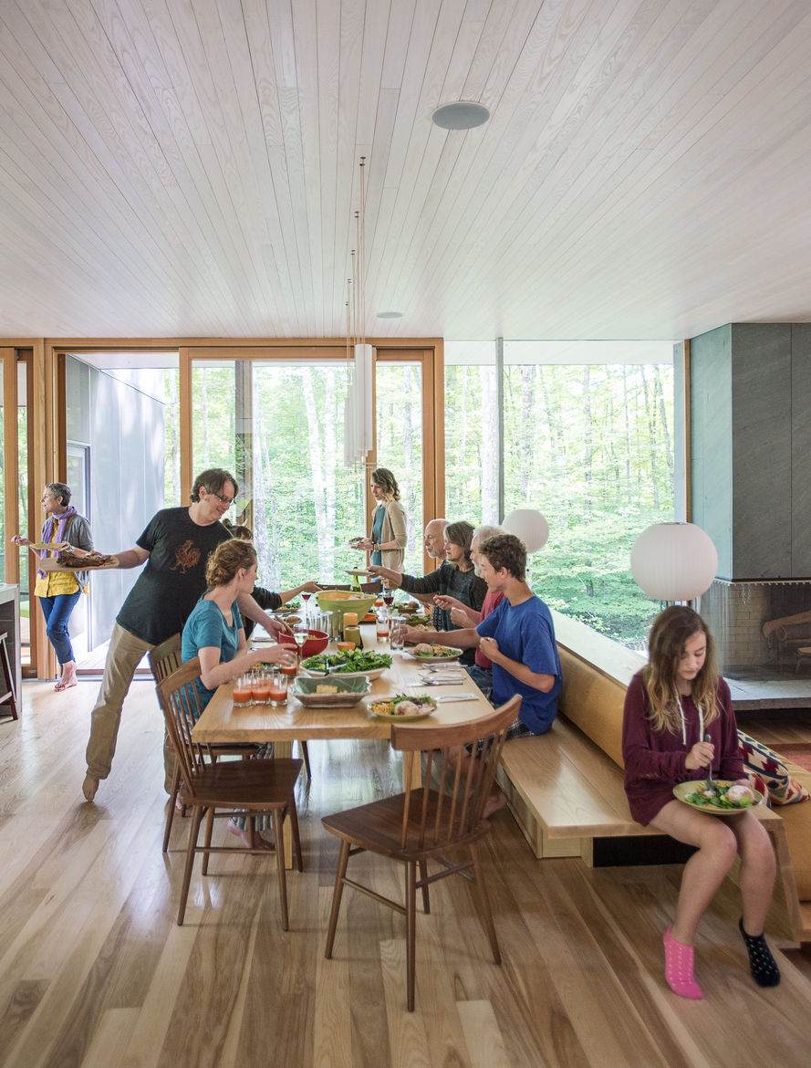 A family gathers around the dining table for a meal