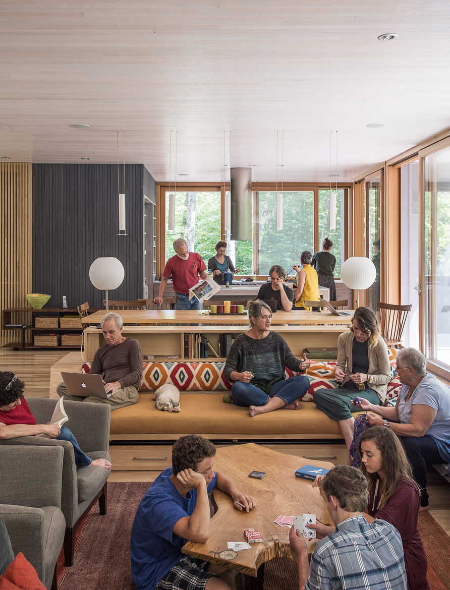 Three generations of a family in their home by Gray Organschi