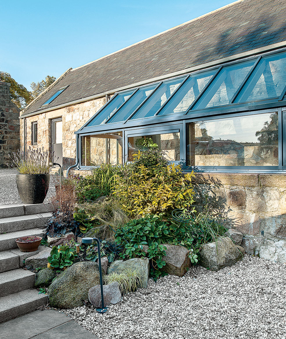 modern renovation addition solar powered scotland glass addition plantings