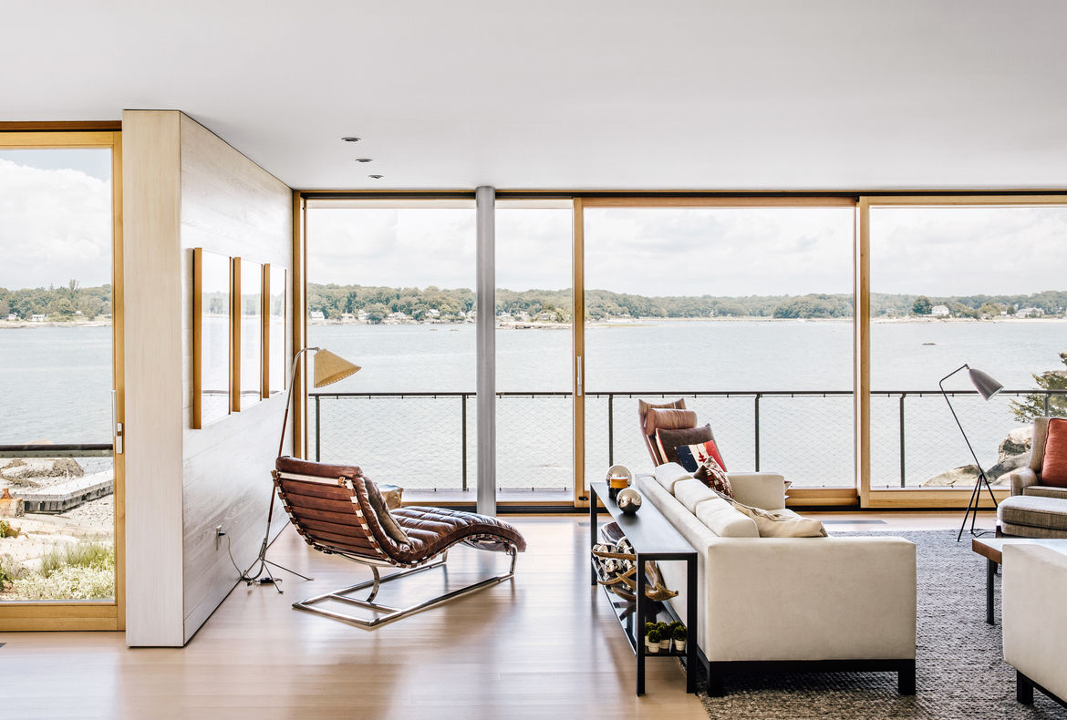 Modern Connecticut summer home renovation with Desiron sofa and Restoration Hardware chaise lounge in the living room