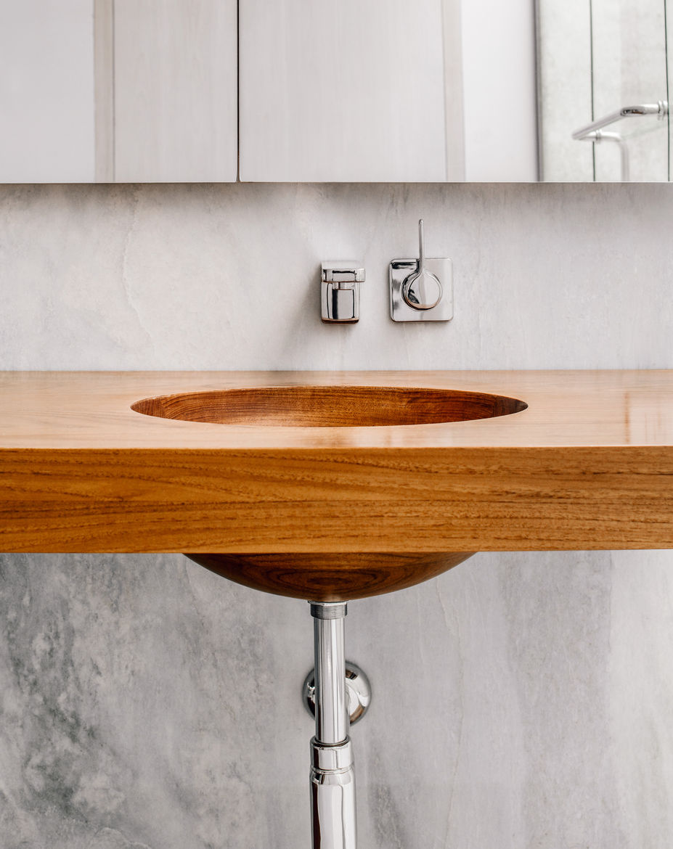 Modern Connecticut summer home renovation with custom teak vanity in the master bathroom