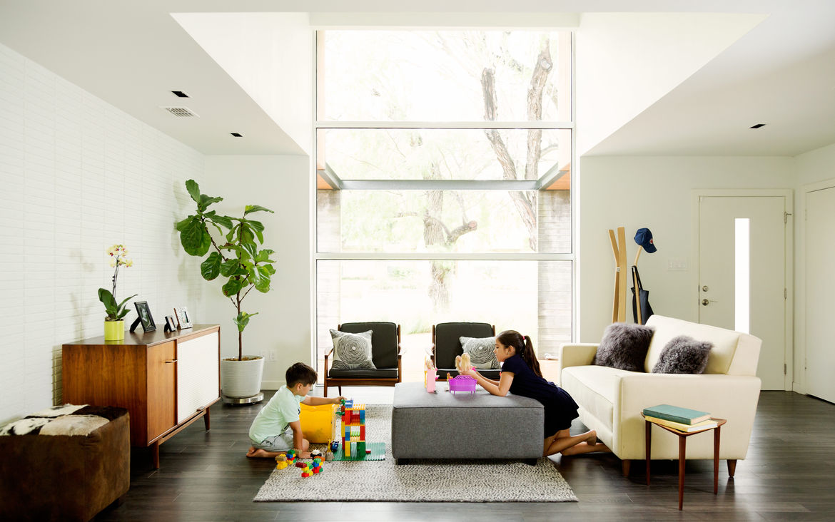 A spacious living room mixes vintage and modern furniture.