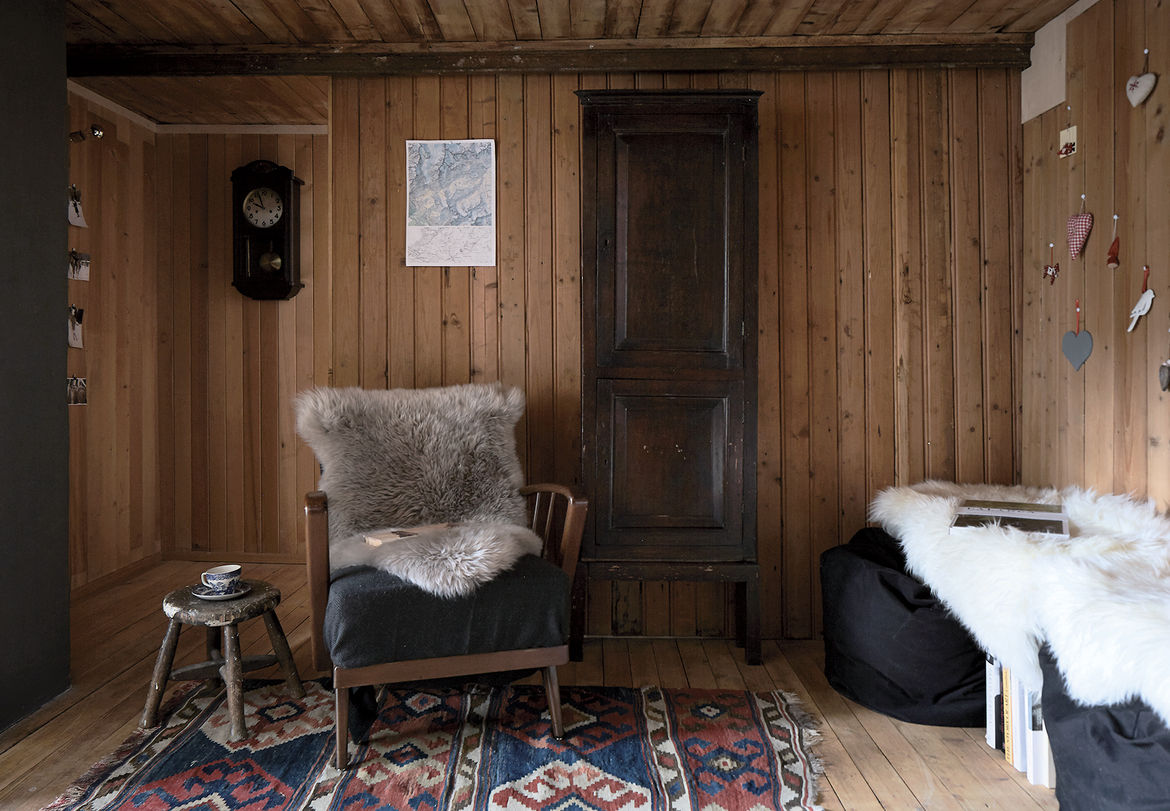 Swiss family getaway small space renovation with stubli and ikea beanbags and heirloom rug