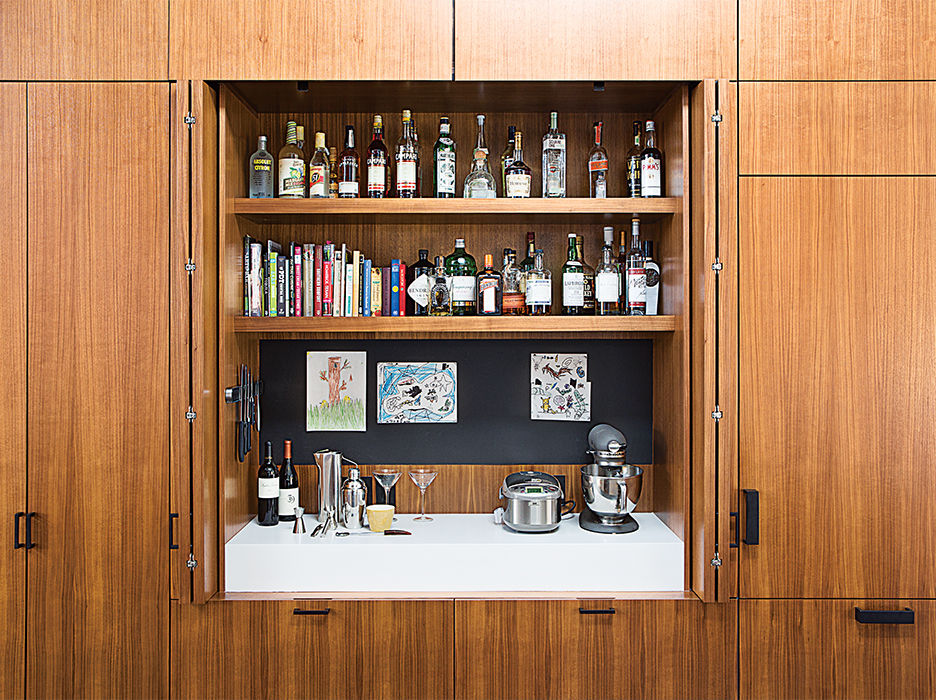 Walnut cabinet with a wet bar inside