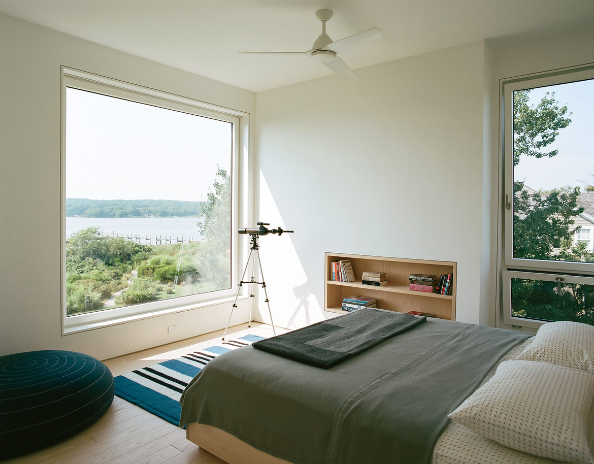 Custom ash frame window with expansive views in master bedroom of Rhode Island family vacation home by Bernheimer Architecture.