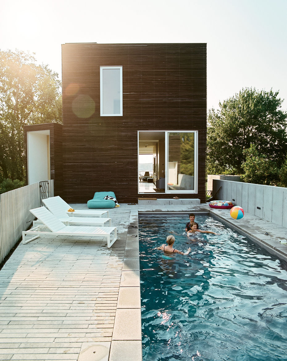 Pool terrace with Eos lounge chairs at Rhode Island family vacation home by Bernheimer Architecture.