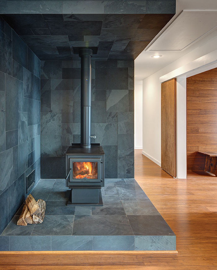 modern green arkansas cabin wood stove slate