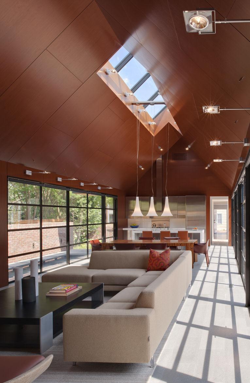 Pietra Serena tiles Monti sofa by Dellarobbia in living room of Delaware renovation by Robert M. Gurney Architect.