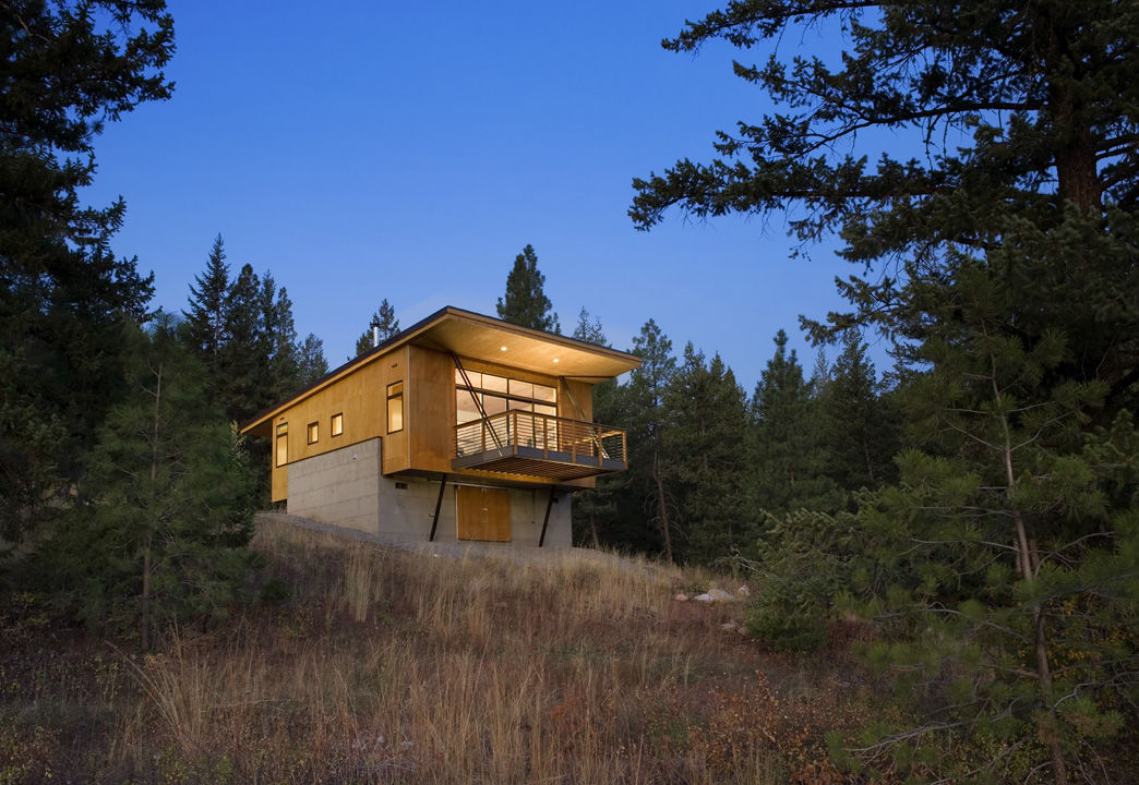 Pine Forest Cabin exterior during evening
