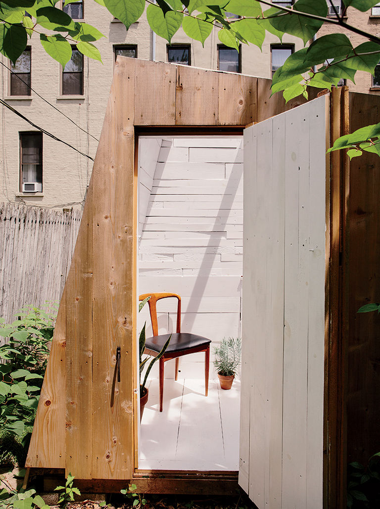 Modern Brooklyn backyard studio entry with plexiglass skylight, green roof, and cedar cladding