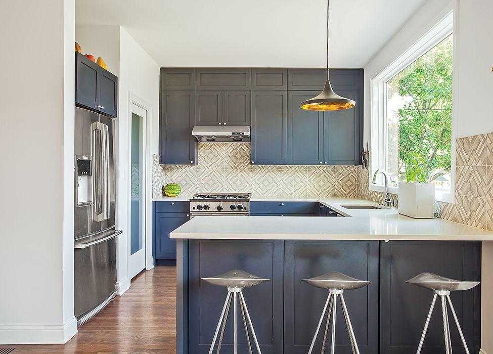 Modern Illinois farmhouse addition kitchen with Mutina cabinets and tiles, Pella window, and kohler faucet
