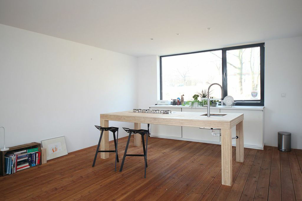 Minimal kitchen with wood island