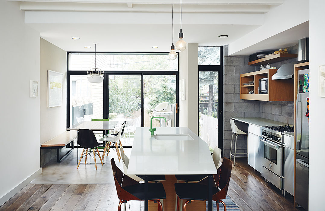 Modern Brooklyn renovation has caeserstone countertop, stainless steel ikea cabinets and green cola faucet in kitchen