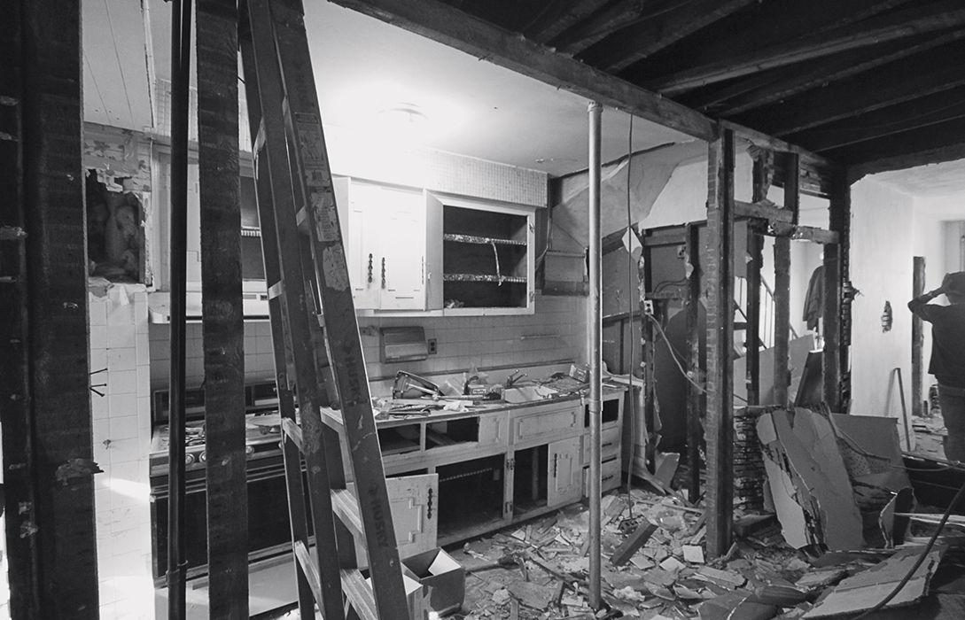 Modern Brooklyn renovation before kitchen workman's cottage
