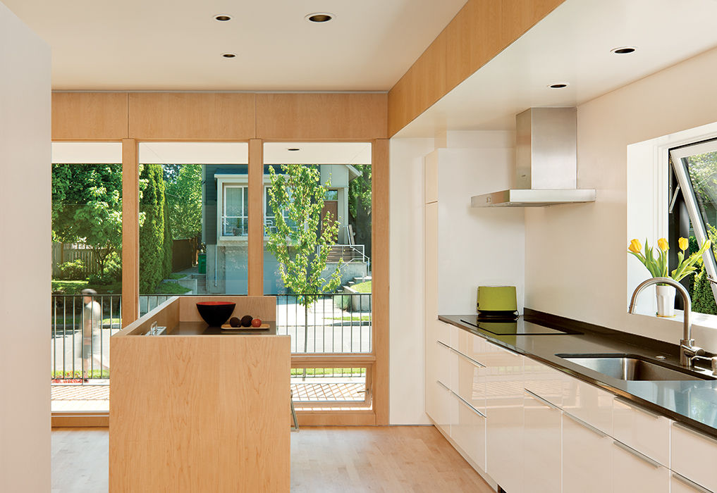 Affordable Portland home with Akurum cabinets and maple island in the kitchen