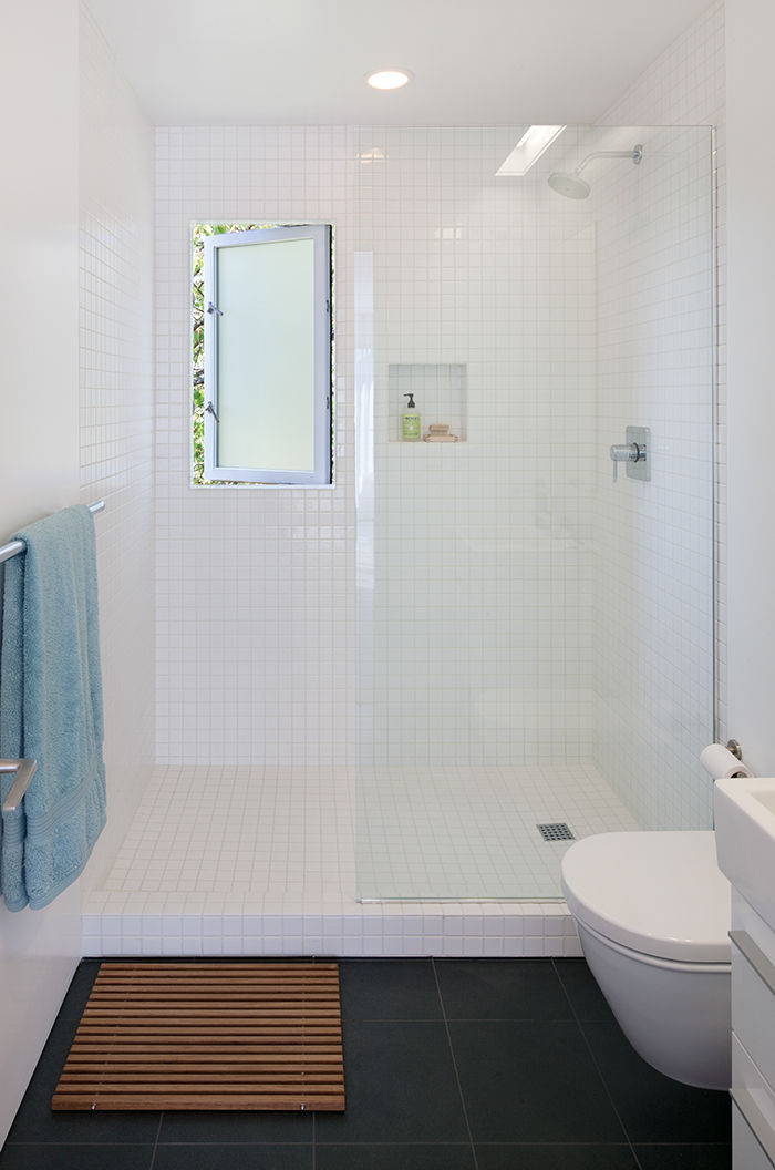 Affordable Portland home master bathroom with tiles and Duravit toilet