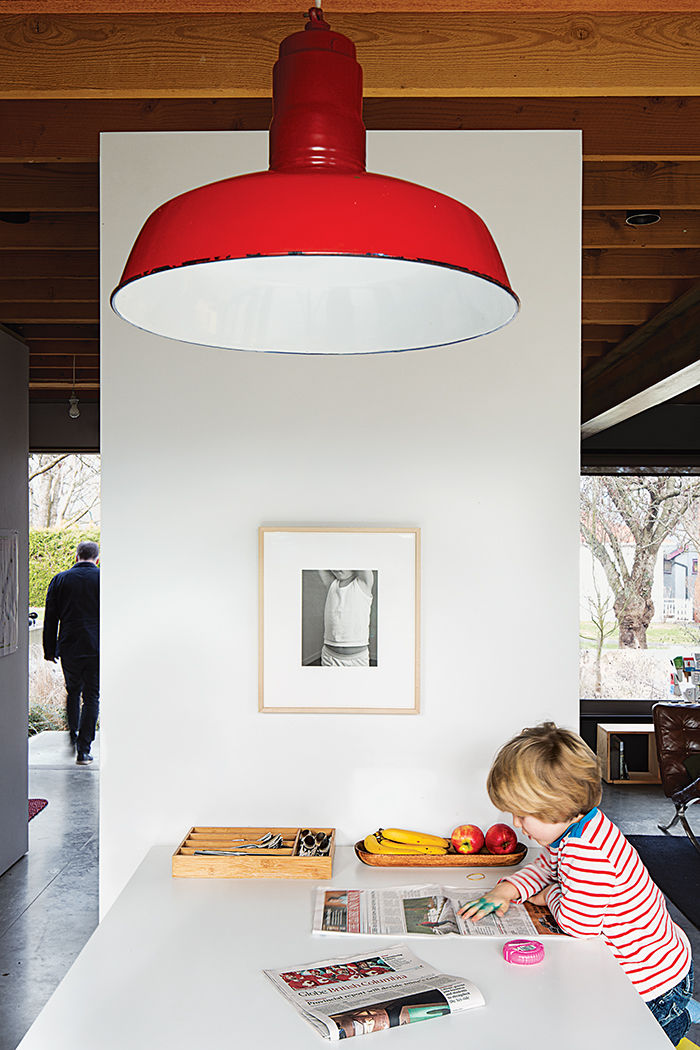 Vintage red pendant light above the kitchen table