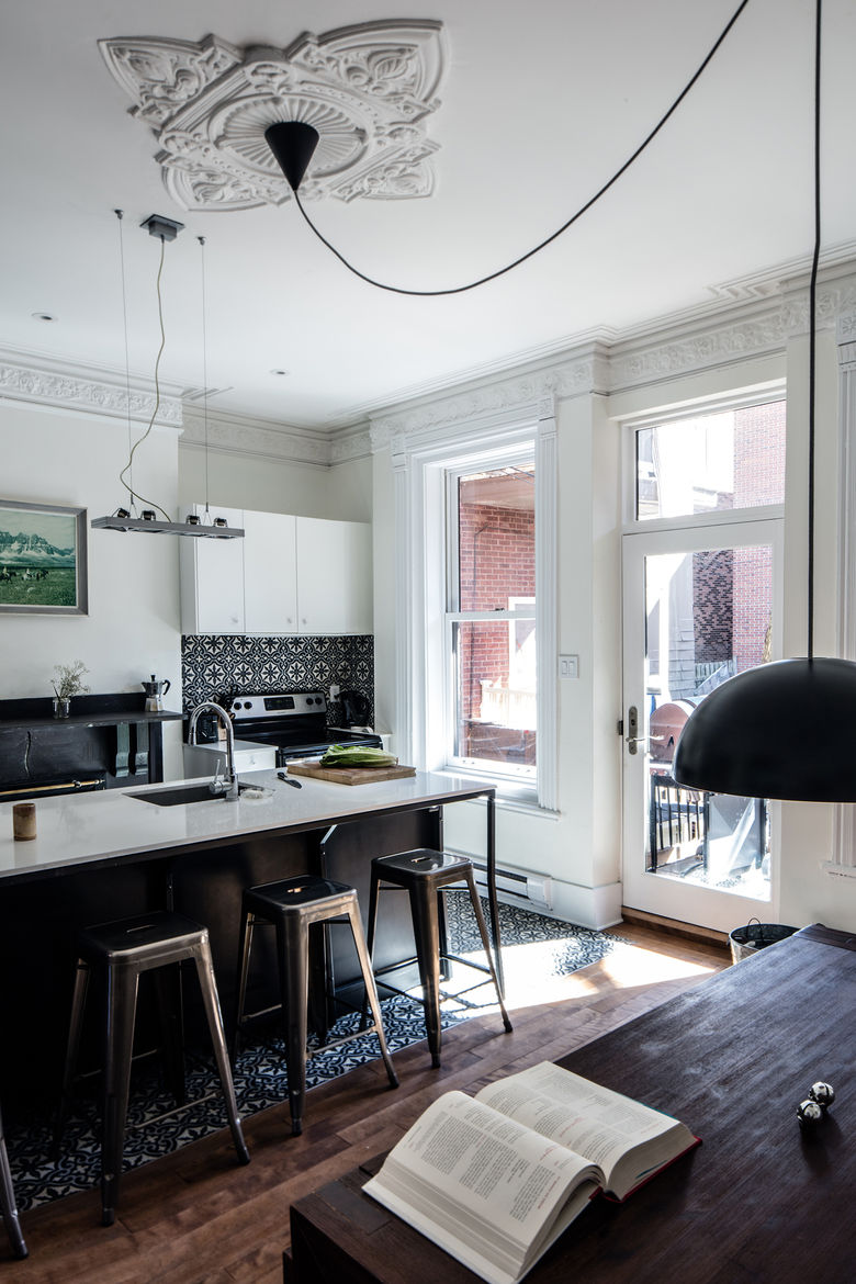 IKEA pendant light with a long extension cord in a Montreal kitchen