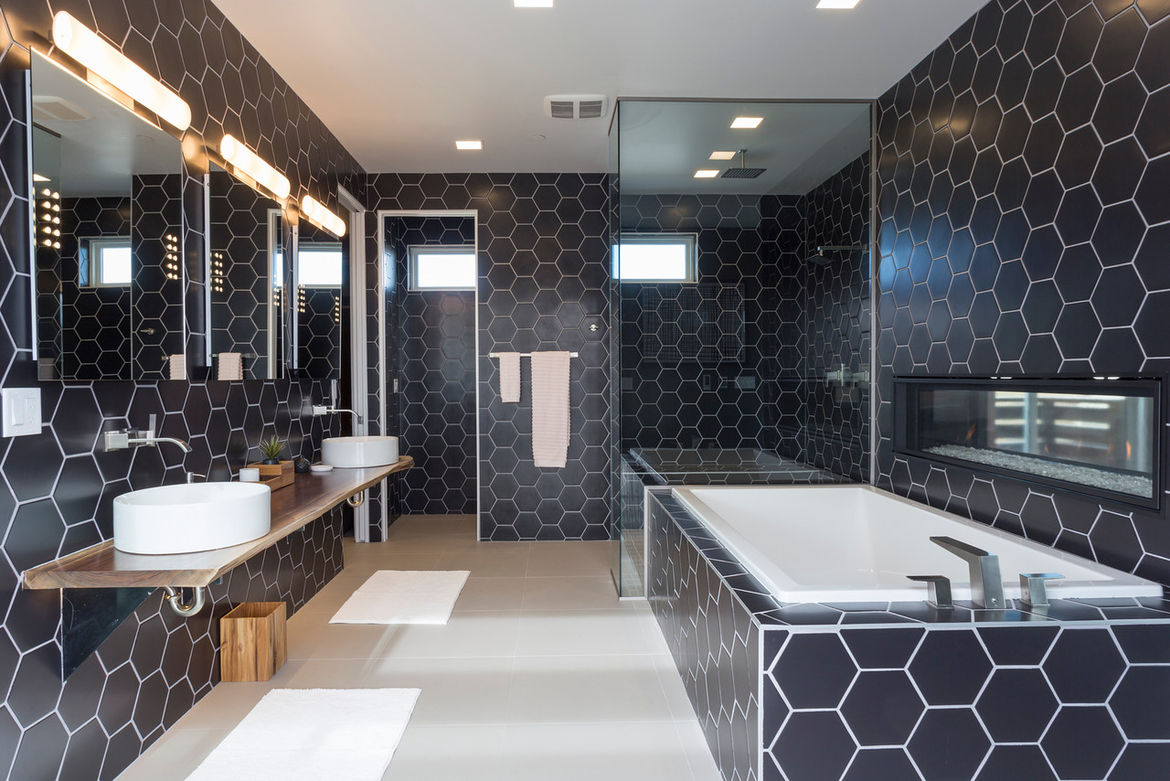 Millennial concept home with a black-tiled bathroom