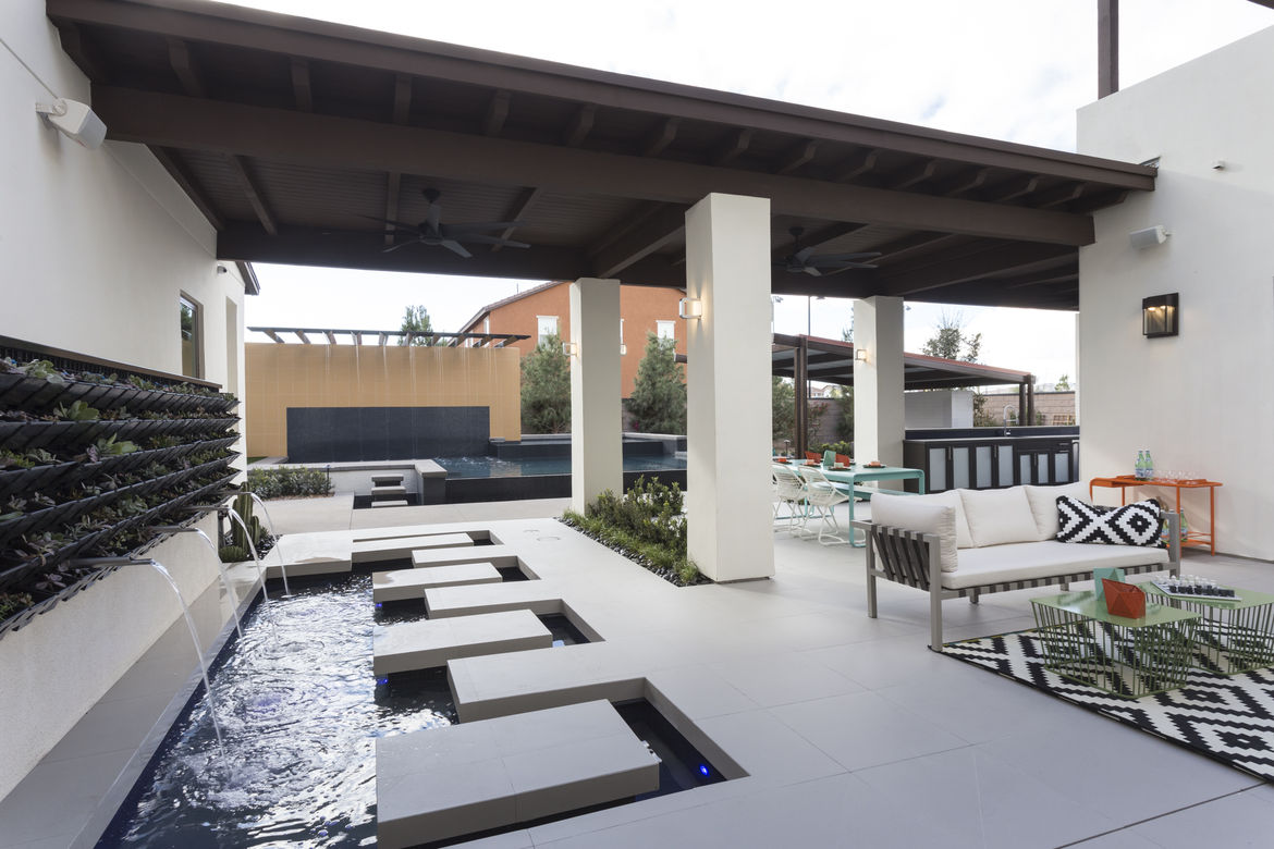 Millennial concept home with an outdoor water feature