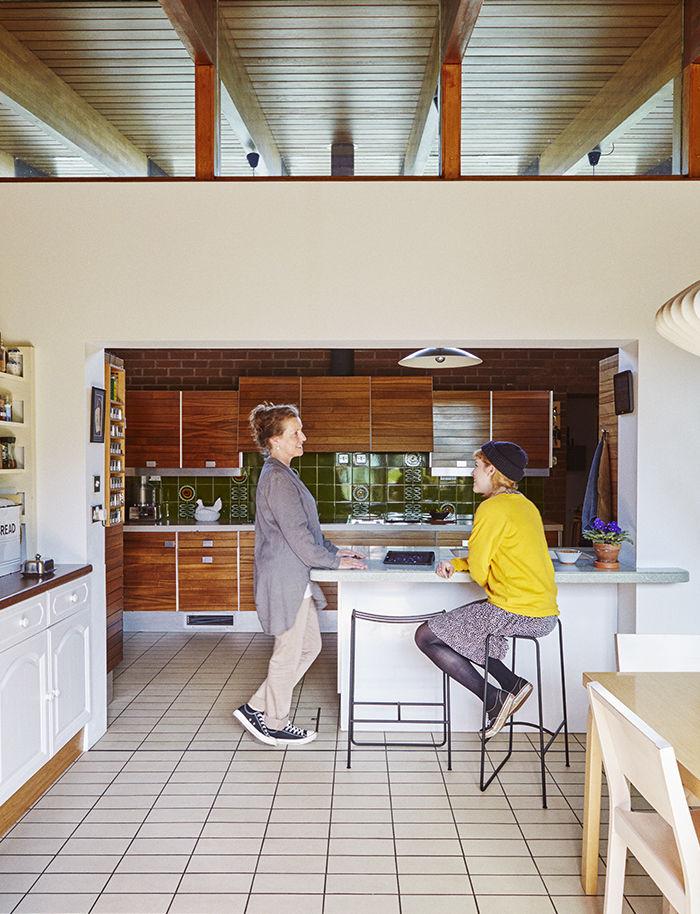 English kitchen with modern Jasper Morrison bar stools