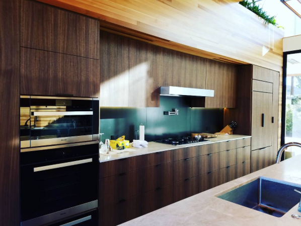 Venice, California kitchen with a black steel backsplash