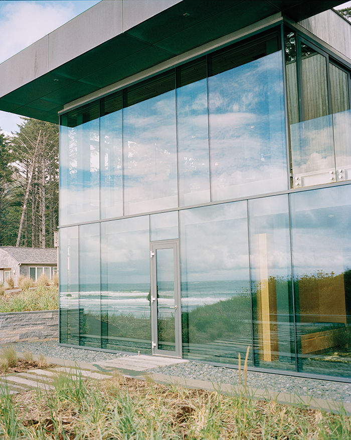 Cannon Beach home has a glass pane and steel frame facade
