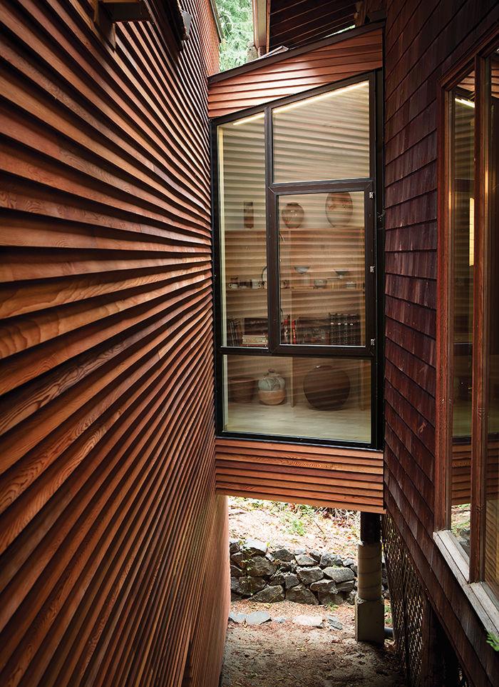 Cedar siding bridge with a window on a modern addition