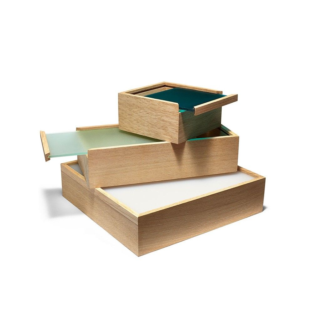 Three storage boxes with colorful acrylic lids