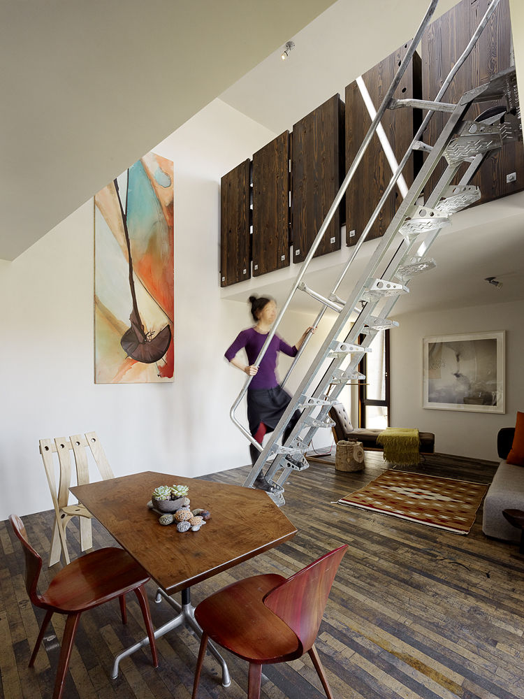 Ladder stairs, dining and living areas in a San Francisco net-zero cottage