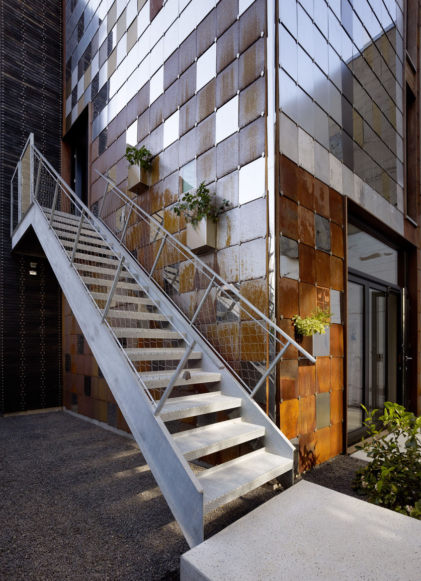 Exterior stairs and metal shingles at the San Francisco net-zero cottage
