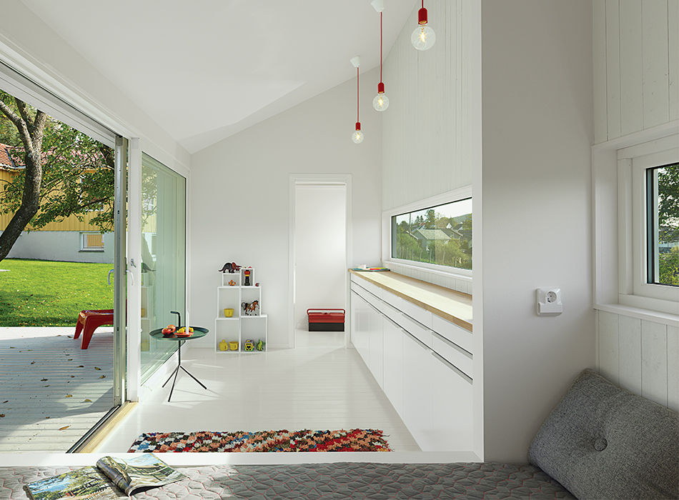 modern guesthouse in norway with angular facade and interior with Thomas Bentzen table, Hay cushions, and Muuto pendant lamps