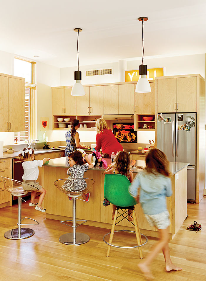 Modular Texas home kitchen with maple island and bar stools