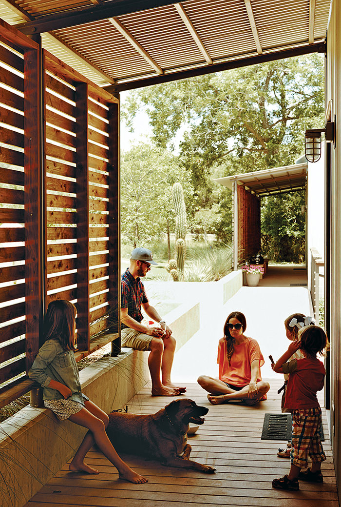 Modular Texas home with red cedar screens covering the walkway