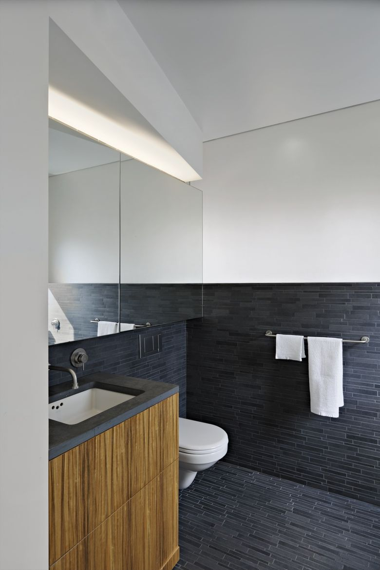 Master bathroom with gray tiles